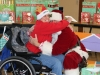 stepping-stones-camp-allyn-holiday-party-santa-hug-batavia-ohio