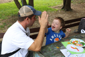 Construction Workers Volunteer at Stepping Stones Summer Camp